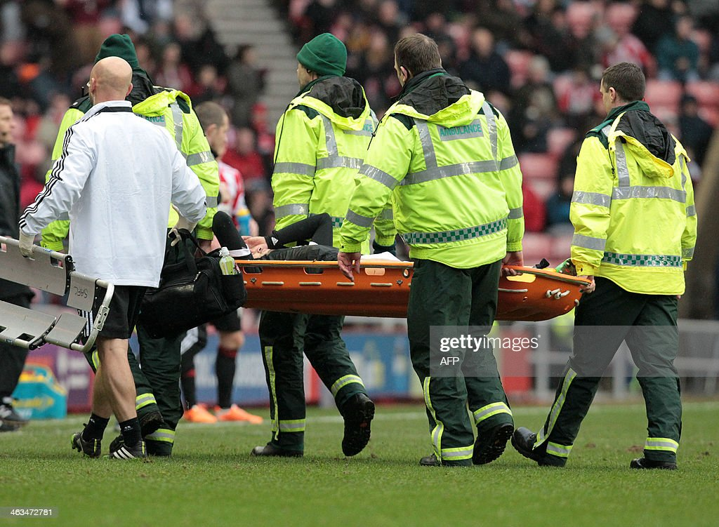 Southampton's Uruguayan midfielder Gaston Ramirez injured after a heavy tackle is taken out of play on a stretcher during the English Premier League football match between Sunderland and Southampton at the Stadium of Light in Sunderland, in northeast England, on January 18, 2014. The match ended 2-2. USE. No use with unauthorized audio, video, data, fixture lists, club/league logos or live services. Online in-match use limited to 45 images, no video emulation. No use in betting, games or single club/league/player publications.