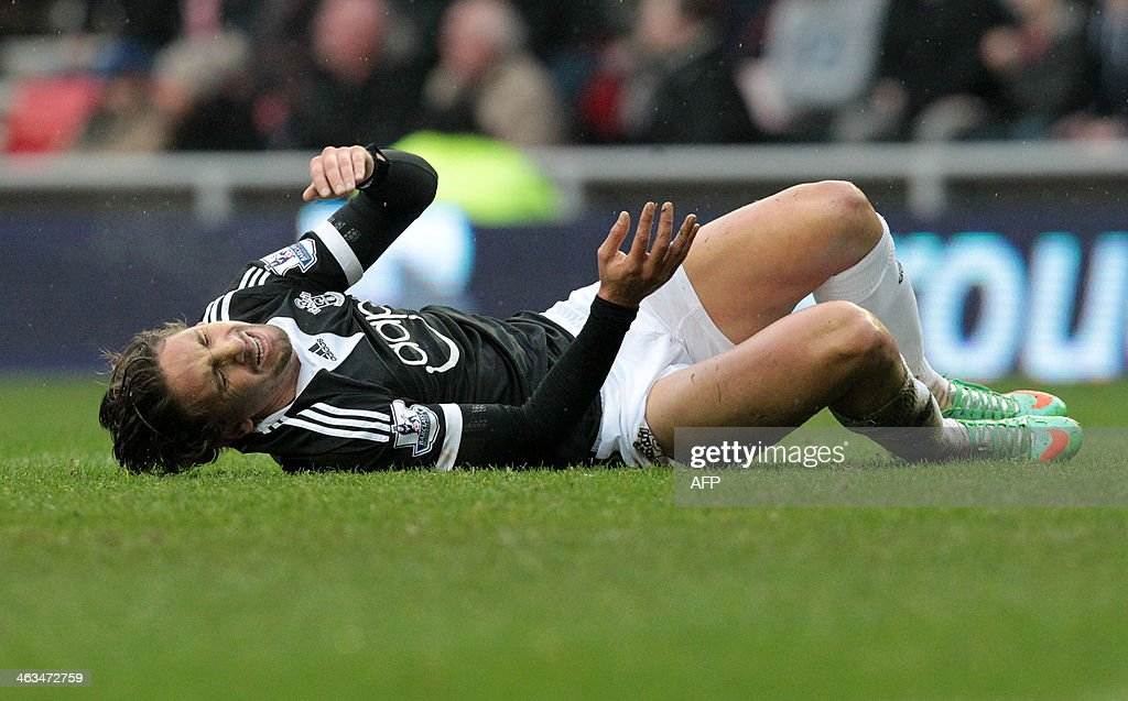 Southampton's Uruguayan midfielder Gaston Ramirez lies injured after a heavy tackle, before being taken out of play on a stretcher, during the English Premier League football match between Sunderland and Southampton at the Stadium of Light in Sunderland, in northeast England, on January 18, 2014. The match ended 2-2. USE. No use with unauthorized audio, video, data, fixture lists, club/league logos or live services. Online in-match use limited to 45 images, no video emulation. No use in betting, games or single club/league/player publications.