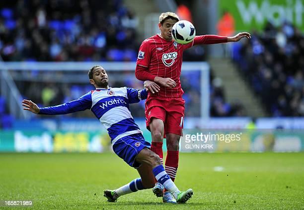 Southampton's Uruguayan midfielder Gaston Ramirez vies with Reading's Jamaican midfielder Jobi McAnuff during the English Premier League football...