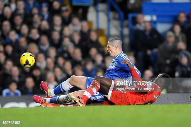 Southampton's Victor Wanyama and Chelsea's Fernando Torres take a tumble whilst battling for the ball