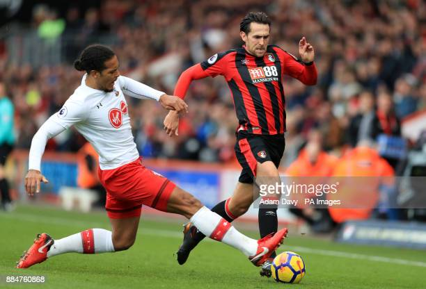 Southampton's Virgil van Dijk and AFC Bournemouth's Charlie Daniels battle for the ball during the Premier League match at the Vitality Stadium...