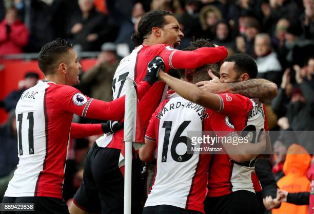 Southampton's Virgil Van Dijk celebrates after Charlie Austin opens the scoring during the Premier League match between Southampton and Arsenal at St...
