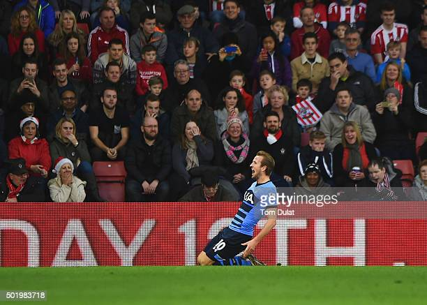 Southamtpn fans look dejected as Harry Kane of Tottenham Hotspur celebrates as he scores their first goal during the Barclays Premier League match...