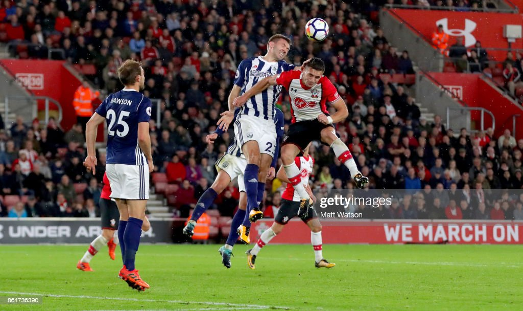 Southanmptonâs Dusan Tadic (right) and Gareth Mcauley during the Premier League match between Southampton and West Bromwich Albion at St Mary's Stadium on October 21, 2017 in Southampton, England.