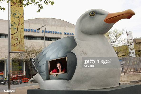 Southbank Centre employee admires a sculpture by Mark Dion entitled 'Mobile Gull Appreciation Unit' outside the Royal Festival Hall on April 18 2011...