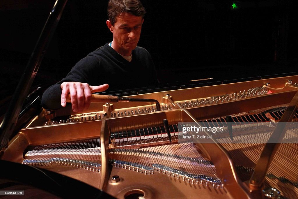 Southbank Centre's Concert piano technician <a gi-track='captionPersonalityLinkClicked' href=/galleries/search?phrase=John+Heard&family=editorial&specificpeople=1544711 ng-click='$event.stopPropagation()'>John Heard</a> tunes the Steinway concert grand piano before Chinese classical pianist Yuja Wang performs on stage during her evening solo piano recital, featuring works by composers Rachmaninov, Beethoven, Scriabin and Prokofiev, for the International Piano Series at Queen Elizabeth Hall at Southbank Centre on May 1, 2012 in London, United Kingdom.