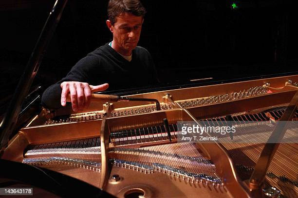Southbank Centre's Concert piano technician John Heard tunes the Steinway concert grand piano before Chinese classical pianist Yuja Wang performs on...
