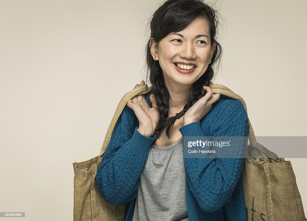 Southeast Asian woman with shopping bags : Stock Photo