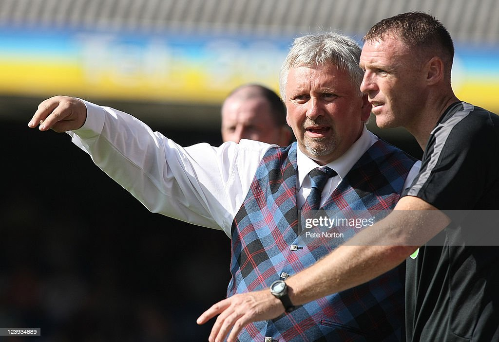 Southend United manager <a gi-track='captionPersonalityLinkClicked' href=/galleries/search?phrase=Paul+Sturrock&family=editorial&specificpeople=227206 ng-click='$event.stopPropagation()'>Paul Sturrock</a> (L) and coach Graham Coughlan look on during the npower League Two match between Southend United and Northampton Town at Roots Hall on September 3, 2011 in Southend, England.