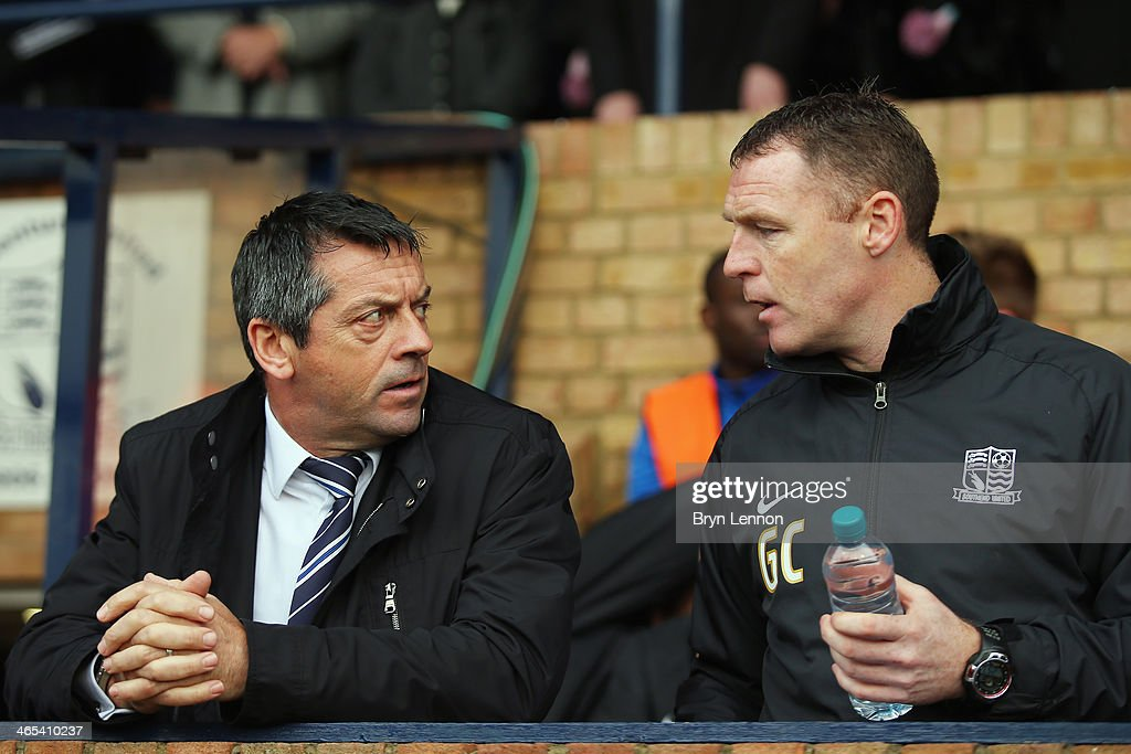 Southend United Manager Phil Brown chats to First Team Coach Graham Coughlan prior to the FA Cup Fourth Round match between Southend United and Hull City at Roots Hall on January 25, 2014 in Southend, England.