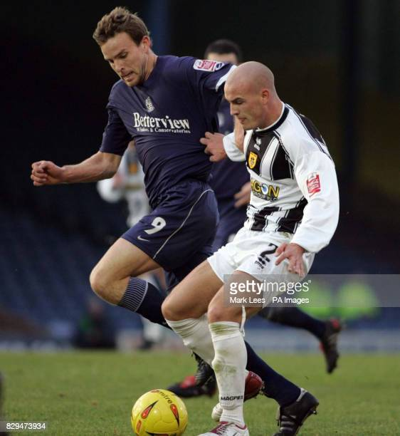 Southend United Mark Bentley is held off by Notts County's David Pipe