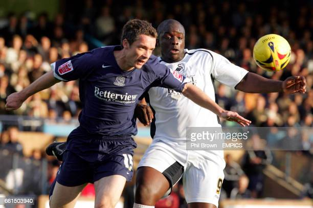 Southend United's Andy Edwards and Swansea City's Adebayo Akinfenwa battle for the ball