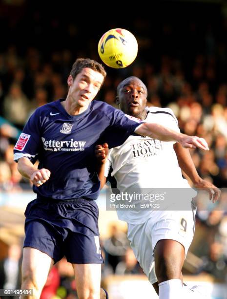 Southend United's Andy Edwards and Swansea's Adebayo Akinfenwa battle for the ball