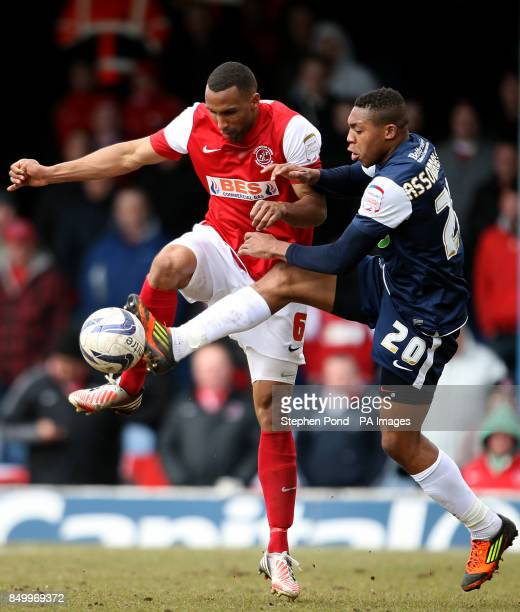 Southend United's Britt Assombalonga and Fleetwood Town's Nathan Pond battle for the ball during the npower Football League Two match at Roots Hall...