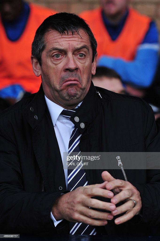 Southend United's English manager Phil Brown looks on before the English FA Cup fourth round football match between Southend United and Hull City at the Roots Hall stadium in Southend on Sea on January 25, 2014. Hull won 2-0.