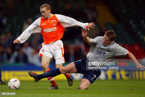 Southend United's Mark Gower slides into tackle Blackpool's Martin Bullock
