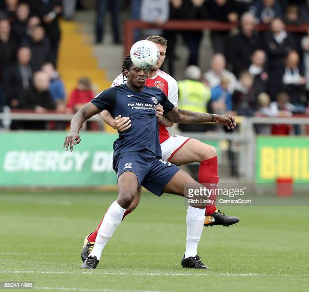 Southend United's Nile Ranger shields the ball from Fleetwood Town's Aiden O'Neill during the Sky Bet League One match between Fleetwood Town and...