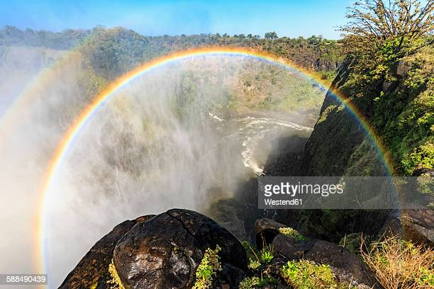 Southern Africa, Zimbabwe, Victoria Falls with rainbow