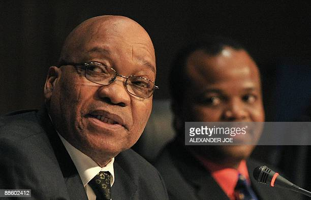 Southern African Development Community chairman South African President Jacob Zuma speaks as King Mswati of Swaziland looks on at a press conference...