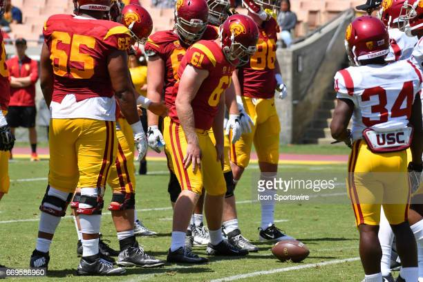 Southern California snapper Jake Olson gets set up to snap the ball during the USC spring football game on April 15 at the Los Angeles Memorial...