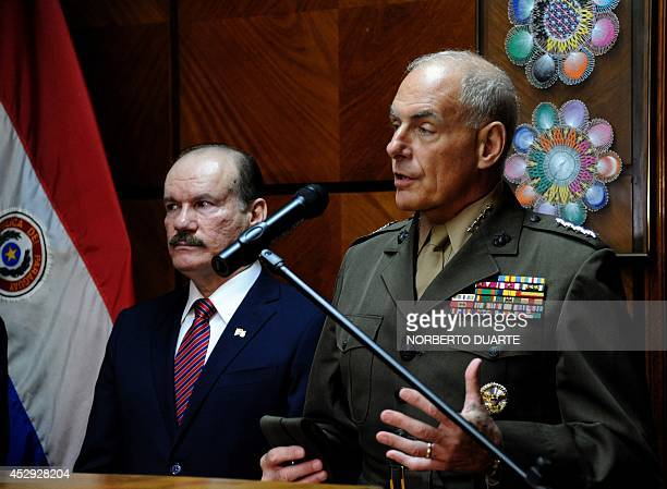 US Southern Command commander General John F Kelly speaks next to Paraguayan Defence Minister Bernardino Soto Estigarribia during a press conference...