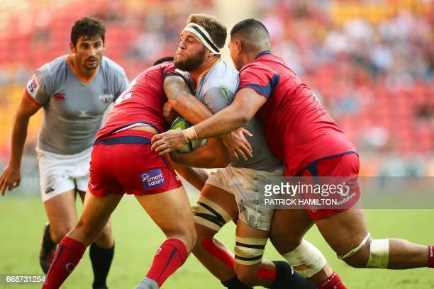 Southern Kings' Irne Herbst is tackled by Queensland Reds' Duncan Paia'aua and Sef Fa'agase during the Super Rugby match between the Queensland Reds...