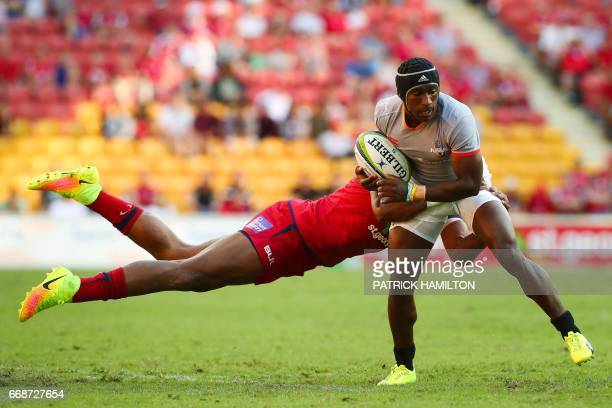 Southern Kings' Masixole Banda is tackled by Queensland Reds' Eto Nabuli during the Super Rugby match between the Queensland Reds and the Southern...