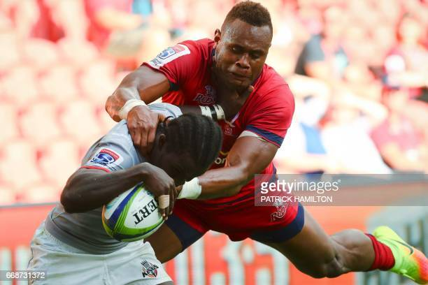 Southern Kings' Yaw Penxe scores as Queensland Reds' Eto Nabuli tackles during the Super Rugby match between the Queensland Reds and the Southern...