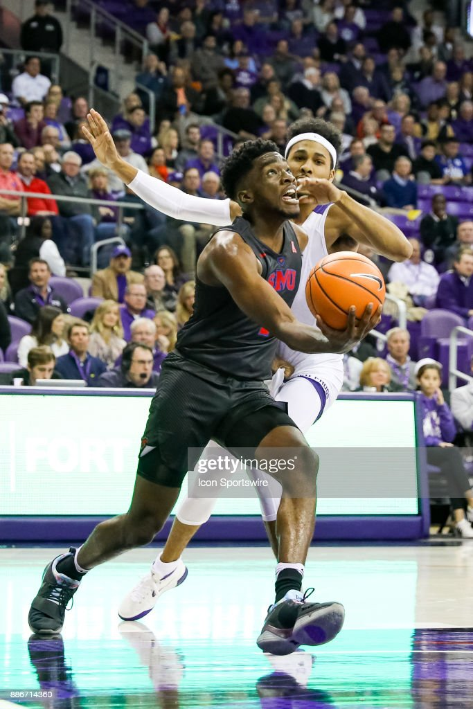 Southern Methodist Mustangs guard Shake Milton (1) drives the lane around TCU Horned Frogs guard Shawn Olden (2) during the game between the SMU Mustangs and TCU Horned Frogs on December 5, 2017 at Ed & Rae Schollmaier Arena in Fort Worth, TX.