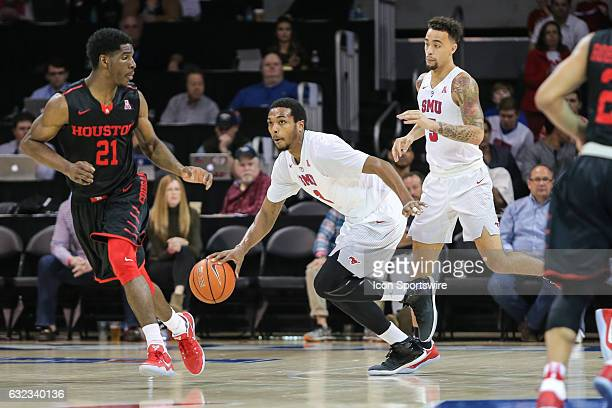 Southern Methodist Mustangs guard Sterling Brown is guarded by Houston Cougars guard Damyean Dotson during the NCAA men's basketball game between the...
