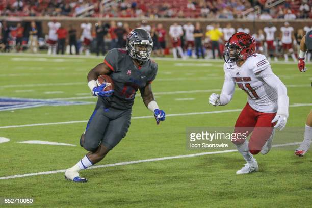Southern Methodist Mustangs running back Ke'Mon Freeman runs around the end during the game between SMU and Arkansas State on September 23 at Gerald...
