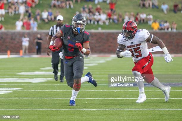 Southern Methodist Mustangs running back Xavier Jones runs from Arkansas State Red Wolves linebacker Kyle Wilson during the game between SMU and...