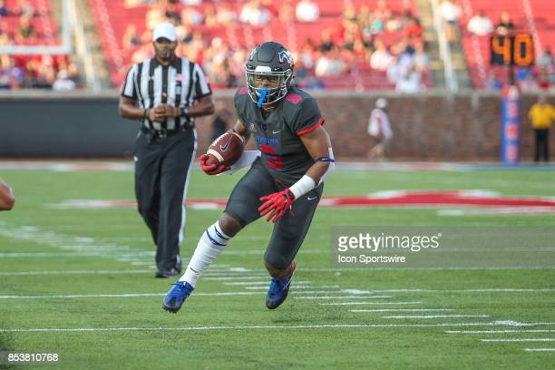 Southern Methodist Mustangs running back Xavier Jones runs up the field during the game between SMU and Arkansas State on September 23 at Gerald J...