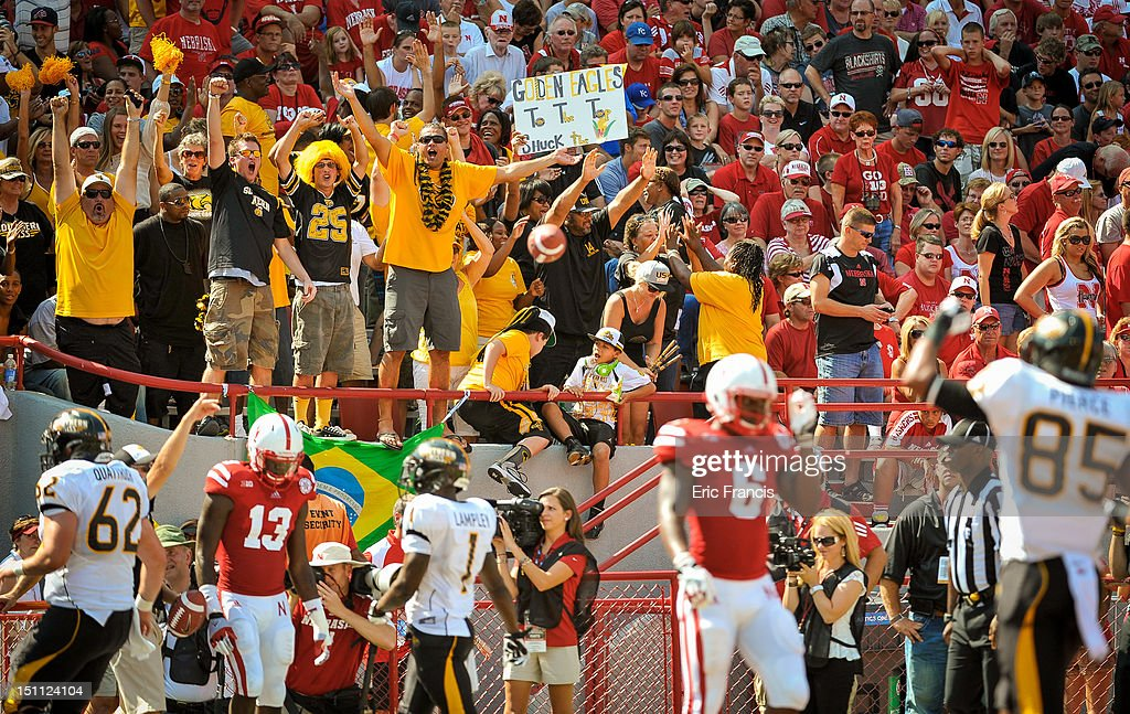 Southern Miss Golden Eagles fans react to an Eagles touchdown during their game against the Nebraska Cornhuskers at Memorial Stadium September 1, 2012 in Lincoln, Nebraska. Nebraska won 40-20.