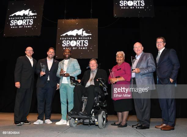 Southern Nevada Sports Hall of Fame Executive Director Dan Dolby Las Vegas Bowl Executive Director John Saccenti boxer Floyd Mayweather Jr IndyCar...