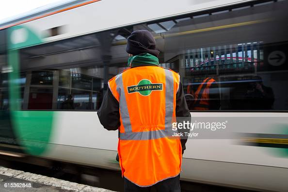 Southern rail conductor looks on as a Southern rail train leaves East Croydon station on October 18 2016 in London England Staff at Southern rail...
