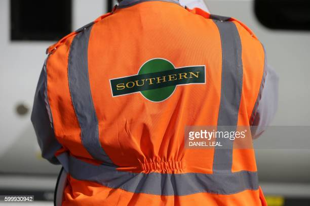 A Southern Rail logo is pictured on the hivis jacket of a train conductor as he works on a platform at East Croydon station south of London on...