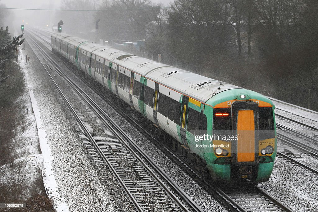 A Southern service train passes through Crawley on January 18, 2013 in Craewley, United Kingdom. Widespread snowfall is affecting most of the UK with school closures and transport disruption. The Met Office has issued a red weather warning for parts of Wales, advising against all non-essential travel as up to 30cm of snow is expected to fall in some areas today.