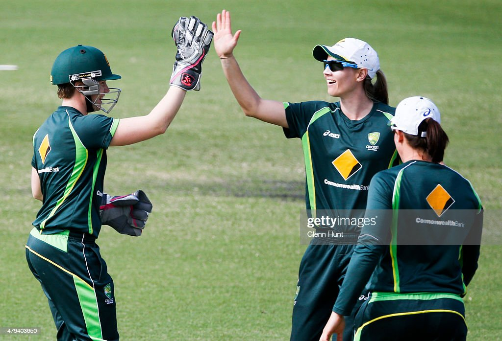 Southern Stars Jess Cameron and Meg Lanning celebrate during the cricket match between the National Indigenous Development Squad and the Southern Stars at Allan Border Field on July 4, 2015 in Brisbane, Australia.