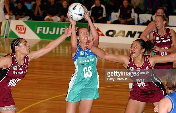 Southern Stings Tania Dalton comes under pressure from the Forces Sheryl Clarke and Linda Vagana during the final of the National Bank netball cup at...