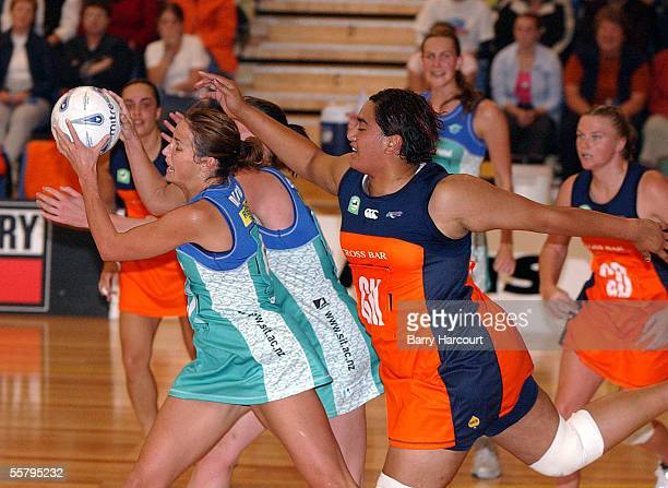 Southern Stings Tania Dalton has Counties Manakau Cometz Monika TupuonoFuimaono bearing down on her during the National Bank Cup netball at...