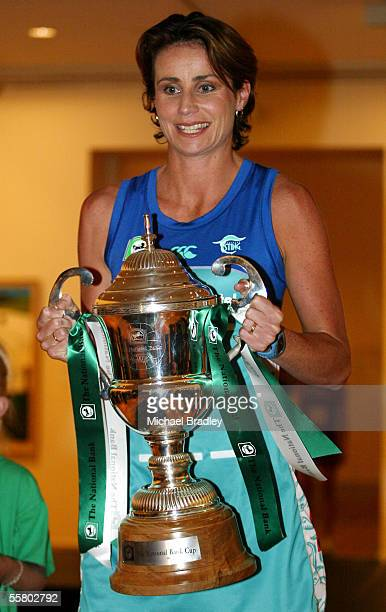 Southern Sting's Tania Dalton holds the National Bank Cup at the media launch for the 2004 netball National Bank Cup held at the Auckland Art Gallery...