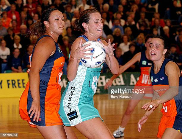 Southern Stings Tania Dalton is pressured by Counties Manakau substitute Owena Zanders and centre Leonie Matoe during the National Bank Cup netball...