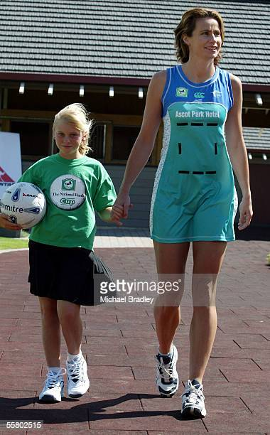 Southern Stings Tania Dalton shows of the new uniform at the launch of the National Bank Cup held at the Westbury Stud The first round of netball...