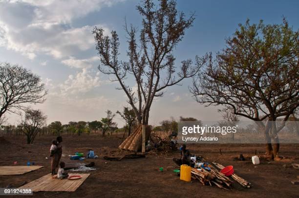 Southern Sudanese families sit on their original land the day they returned to Sudan from refugee camps in Uganda where they spent roughly two...