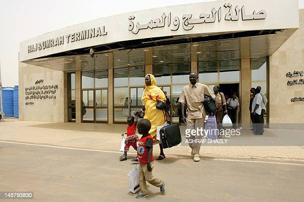 A Southern Sudanese family walks towards an airplane at Khartoum's International airport on June 6 part of the last group of 100 southerners to...