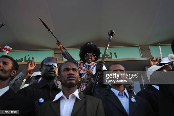 Southern Sudanese villagers and dignitaries hold a rally in celebration of President Bashir in Khartoum Sudan March 7 2009 Bashir continues to show...