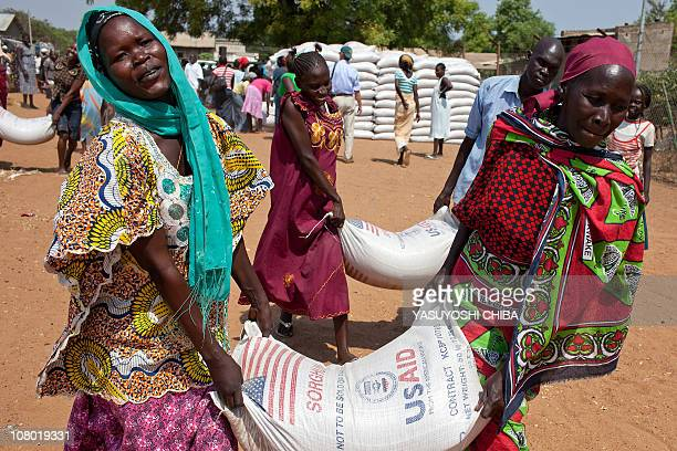 Southern Sudanese women carry sacks of food distributed by the World Food Programme in Juba on January 6 2011 The UN has appealed for over 32 million...