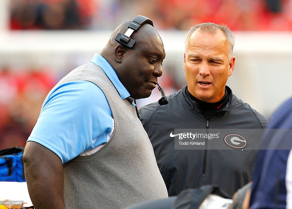 Southern University Jaguars head coach Dawson Odums speaks with Georgia Bulldogs head coach Mark Richt as medics tended to wide receiver Devon Gales...