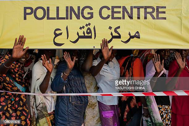 Southern women wave goodebye to northern Sudan as they queue at a polling station in the southern town of Bentiu capital of oilproducing Unity state...
